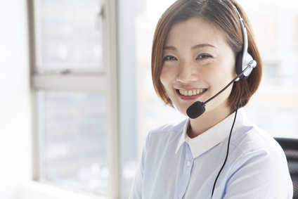 Women smiling and wearing a headset